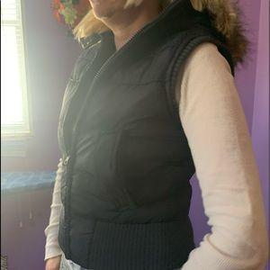 Gray women's Winter Vest with a faux fur hood.
